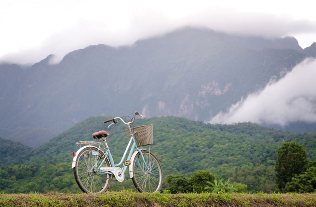 white bike overlooking the lush mountains of Epidaurus