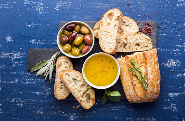 Nafplion Food Tasting Tour: bread olives and olive oil on a table