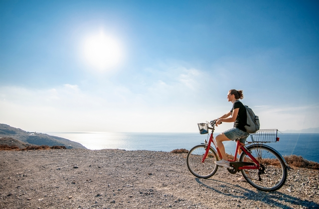 woman cyclist cycling by the sea in Nafplio