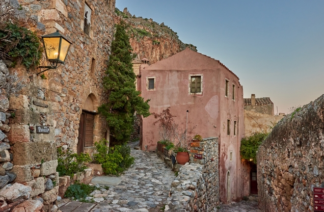 pink building with stone wall around it in Monemvasia