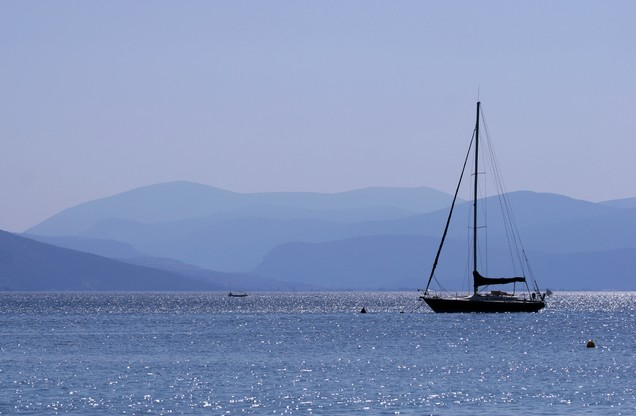 sailing boat in the blue sea