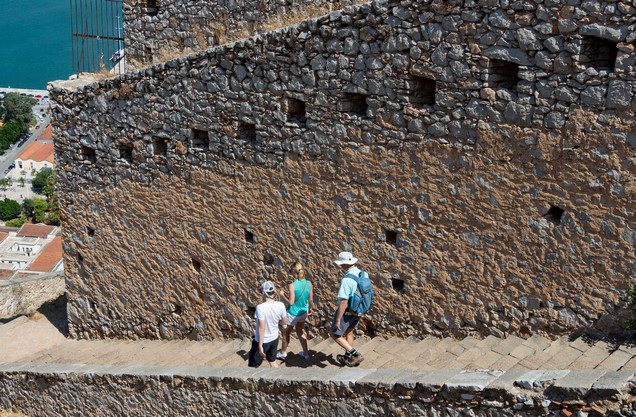people go down the stairs from Palamidi Castle in Nafplio