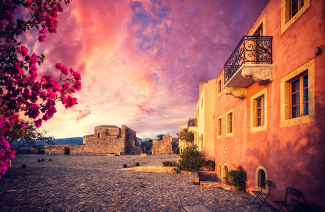Nafplion Monemvasia Castle Tour: buildings illuminated by the sunshine at sunset in Monemvasia