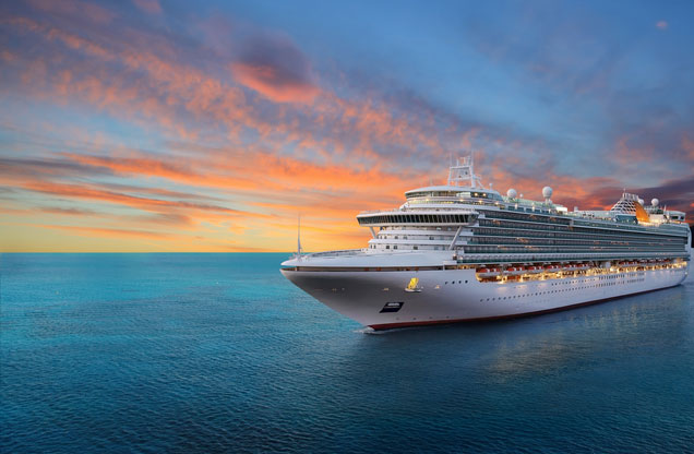 Tours from Cruise Ships: a cruise ship sails in the clear blue waters of the Aegean at sunset