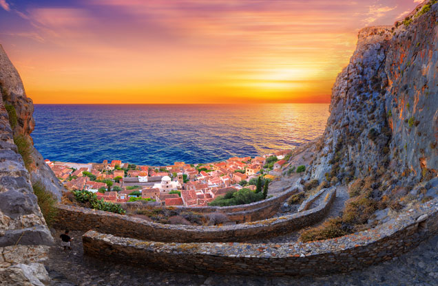 Multi Day Tours: the view of the sea at sunset over the castles of Monemvasia