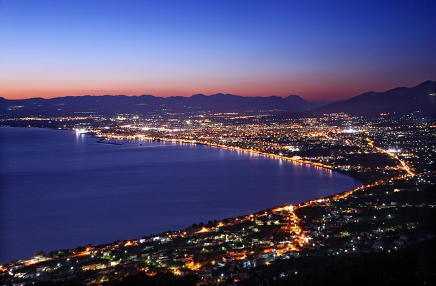 the beach and the city of Kalamata Greece illuminated at night