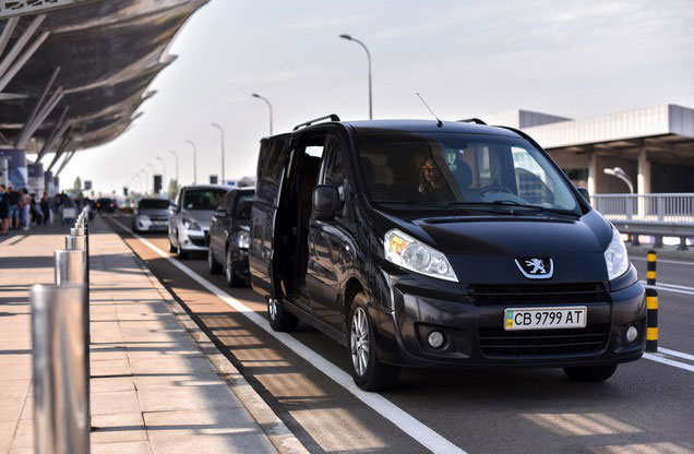 Athens Airport El.Venizelos to or from Ermioni, Portoheli or Costa: black luxury van parked outside the airport