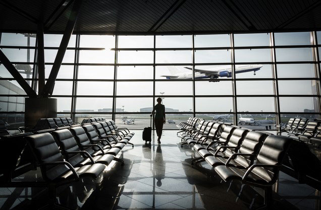 Athens Airport El.Venizelos to or from Kalamata: a man looks at the planes flying out of the airport window