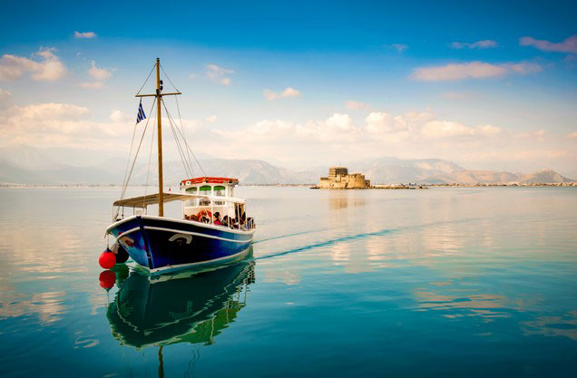 Nafplion to Sparta-Mystras and return: A boat is sailing in the blue waters of the sea in Nafplio