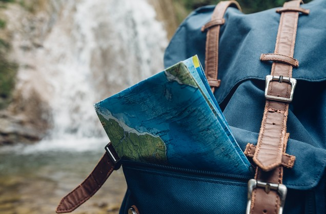 Hiking in Navarino: a travel backpack with a map