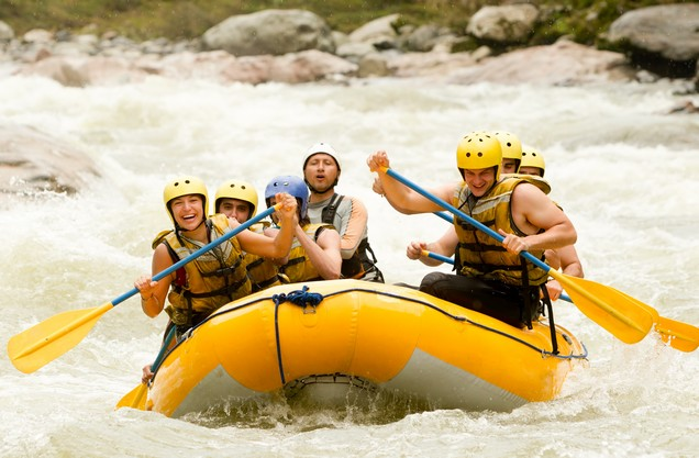 Rafting in Lousios river: Group of people rafting in the rapids of Lucius River