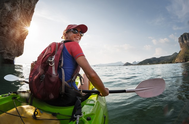 a woman does kayaking on the sea