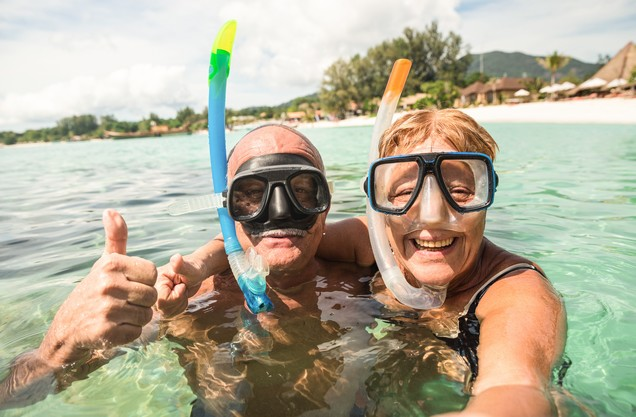 a couple wearing a sea mask