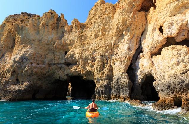 a man kayaking on the sea