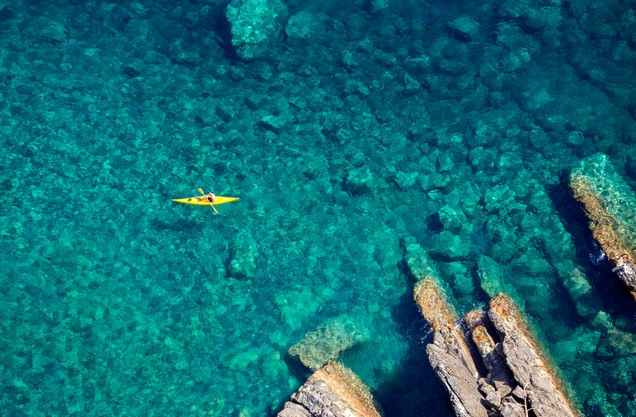 a canoe in the crystal clear waters of the Kardamyli Sea