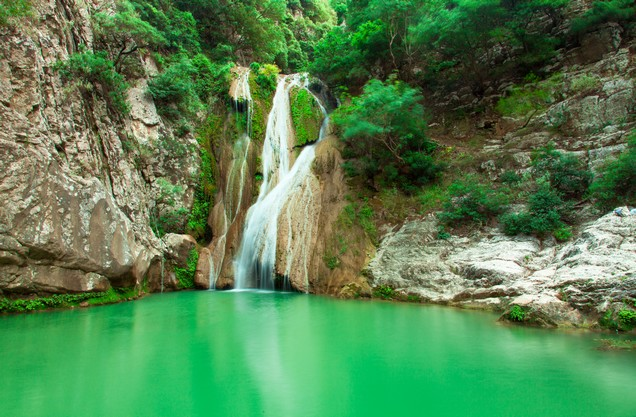 a waterfall on a lake in Polylimnio in the Peloponnese