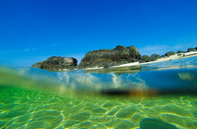the crystal clear waters of the sea