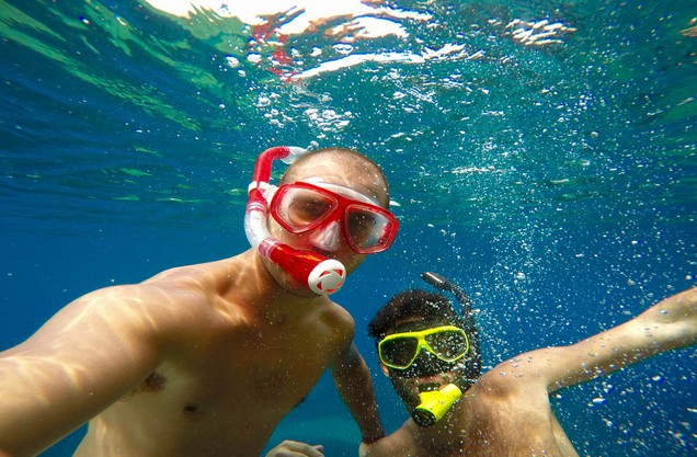 two men under water with sea masks