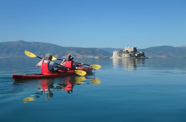 people doing kayak in front of the medieval castles of Nafplio